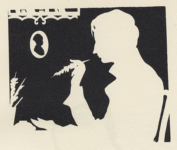 reverse silhouette of profile of man with quill pen
