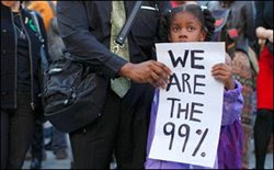 Little girl holds 'We are the 99-percent' sign