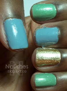 Manicure with nails painted in metallic gold, shimmery pastel mint green, and pastel blue nail polishes