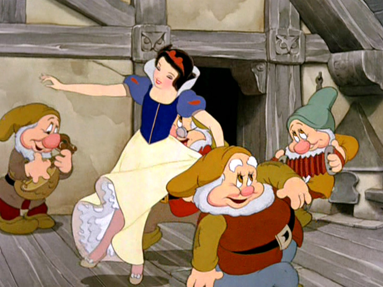 The animated movie snow white and the seven dwarfs directed by david hand supervising seen here the princess snow white dances with the dwarfs