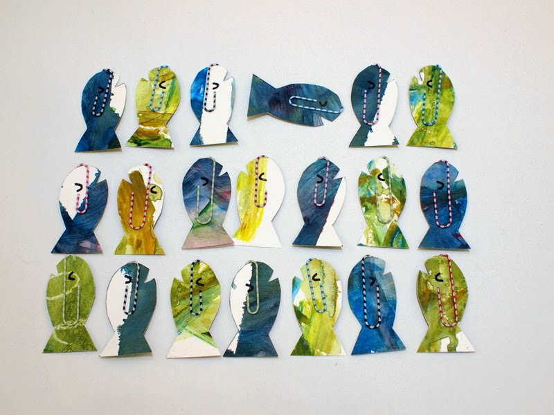 Cut out your fish pieces and attach paper clips