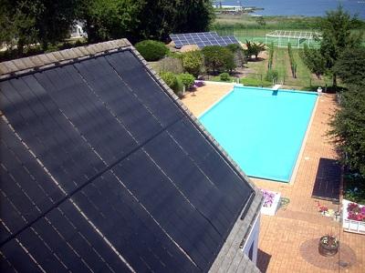 Agua y m s piletas temperadas con energ a solar for Calentar agua piscina
