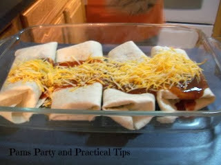 Adding the cheese on the top of the burritos