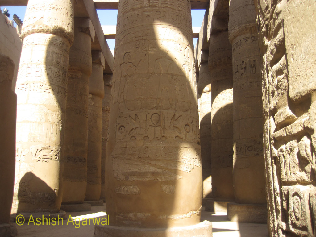 Carvings on a pillar inside the Great Hypostyle Hall in the Karnak temple