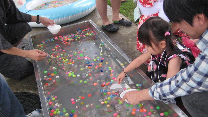 Okonomiyaki life in japan children summer festival for Real life fishing games