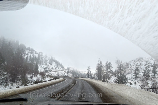 the snowy clouds are thick and low as we drive up the hill