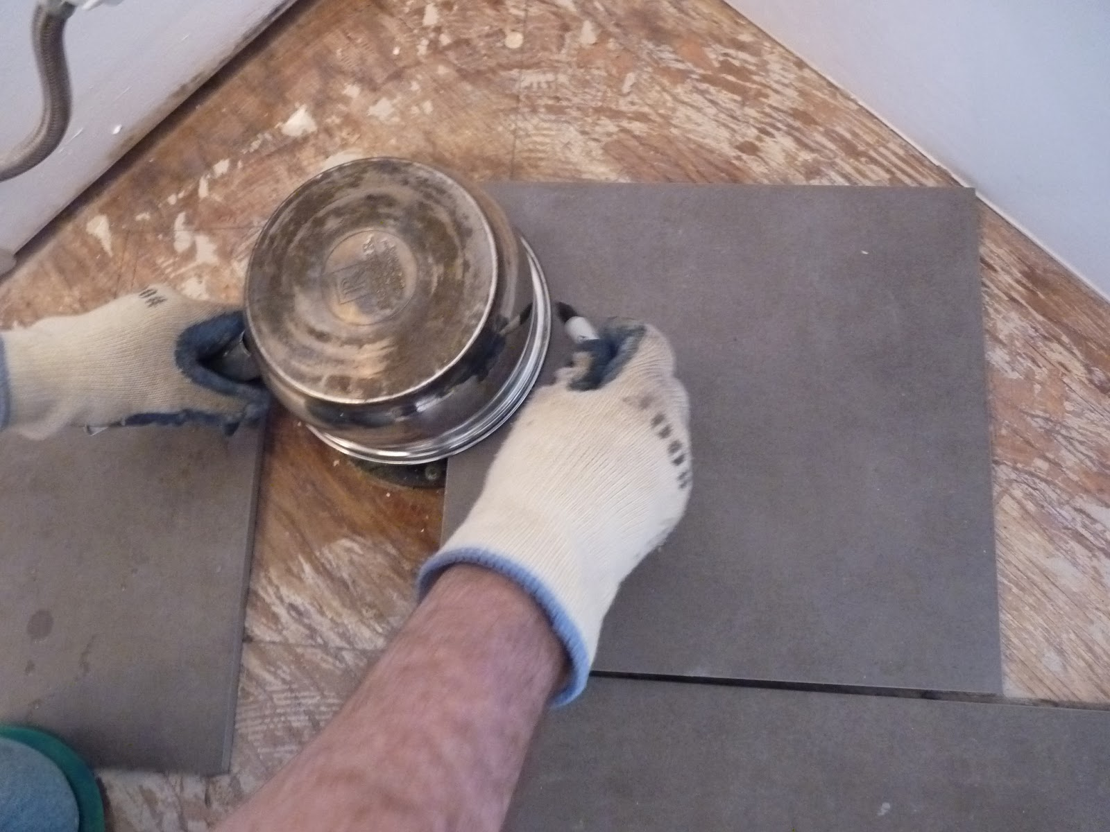 Using A Wet Tile Saw, Make A Cut In The Center Of The Curve Beginning At  The Edge Of The Tile And Ending At The Inside Edge Of The Curve: