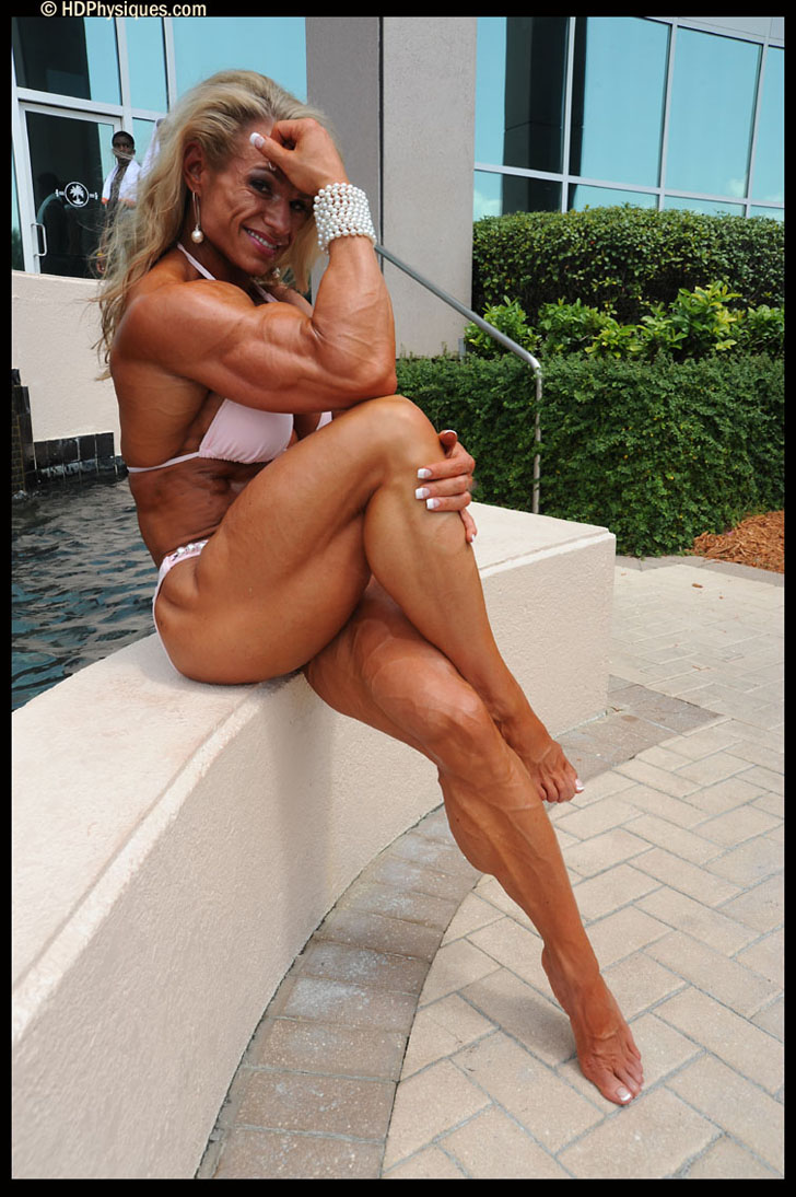 Tina Chandler Flexing Her Ripped Bicep And Posing Her Shredded Legs