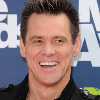 Jim Carrey Posts Tooth Pic To Announce Lloyd Christmas Is Back