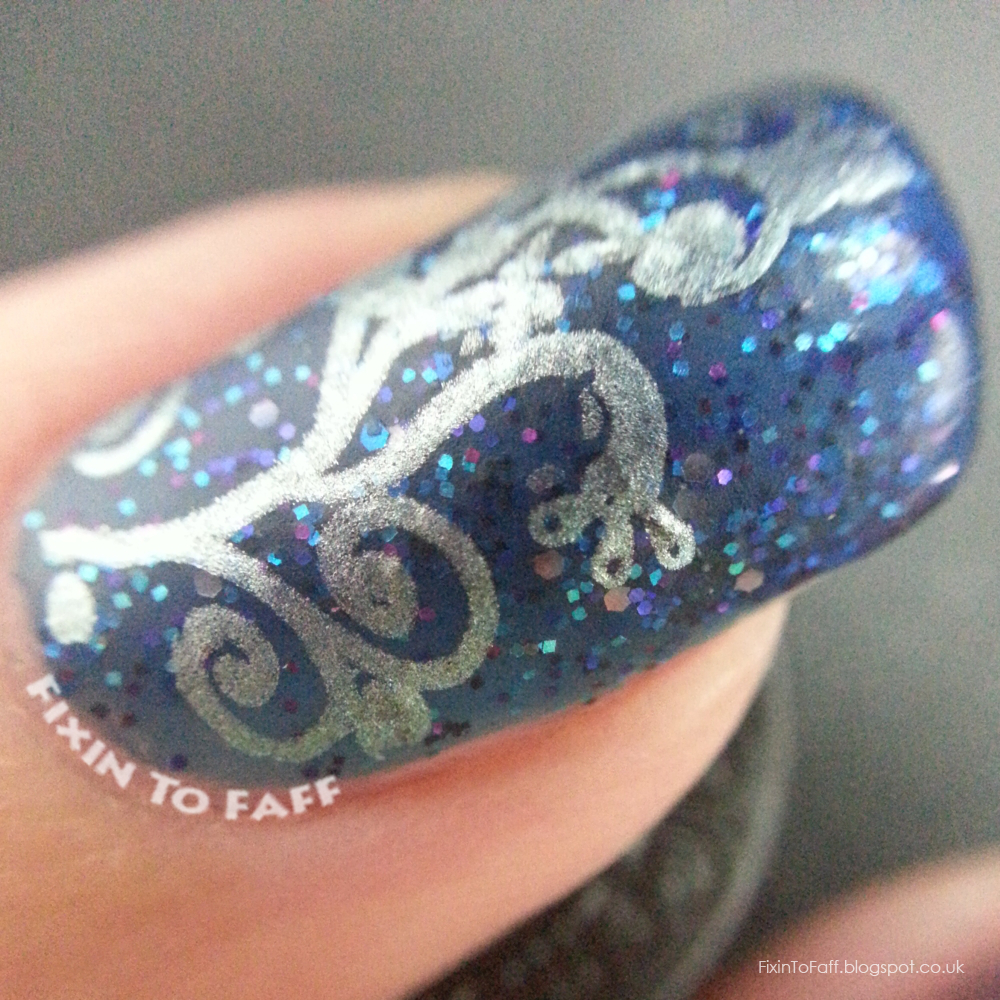 Festive colored chrome stamping over Laquerlicious Sapphire Glaze macro.