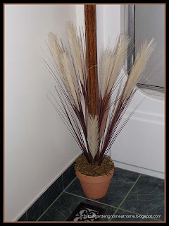 feather and grass decorative planter