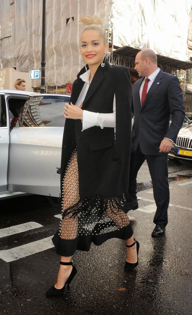 Rita still put a black cape coat in order to avoid cold