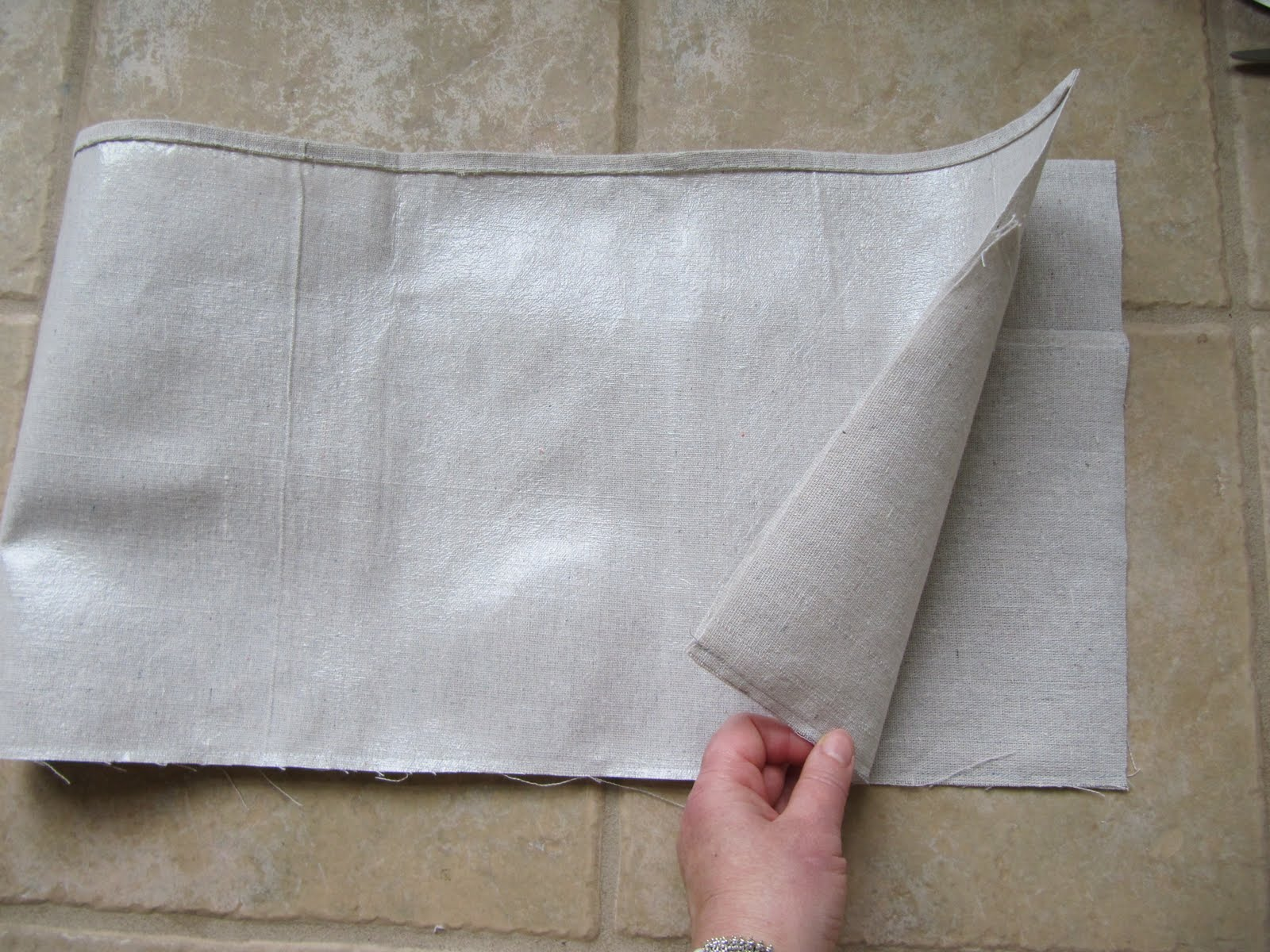 fold over the long piece to join the short edges