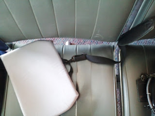 Briefcase strap attached to seat cushion