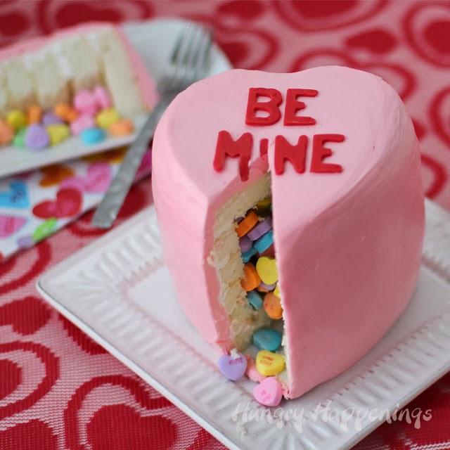 Conversation Heart Piñata Cake | HungryHappenings.com
