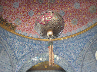 A ornate ball hanging from the ceiling of the Baghdad Pavilion in the Topkapi Palace.