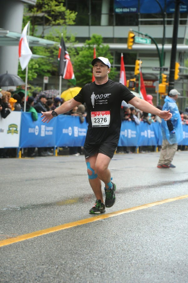 Runner in sight of Finish Line Vancouver Marathon 2014