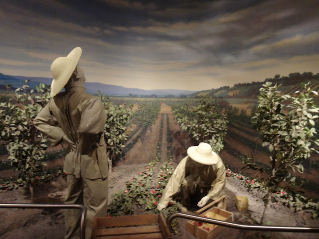 Busy farmers plucking tomatoes in the early days before technology invention at National Museum of American History in Washington DC, USA