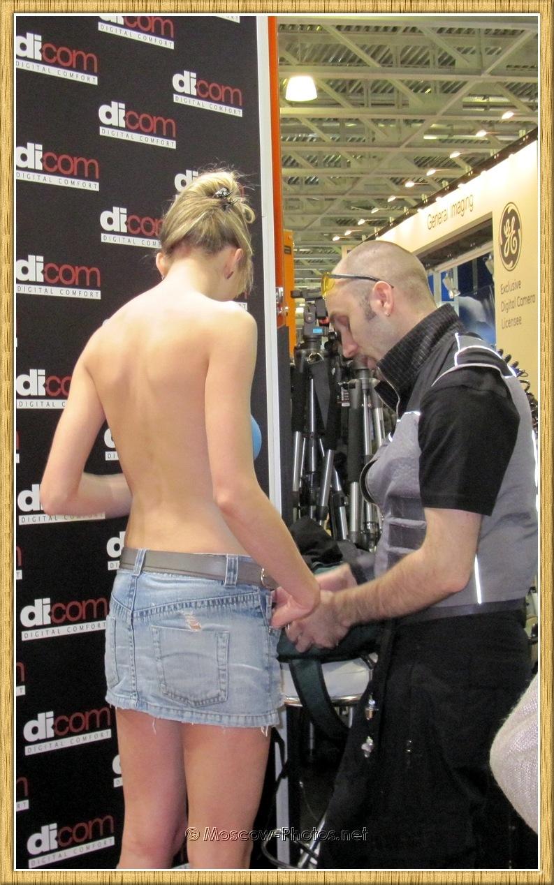Promo-model in denim miniskirt