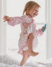 Morning happiness, girl jumping on bed in the morning