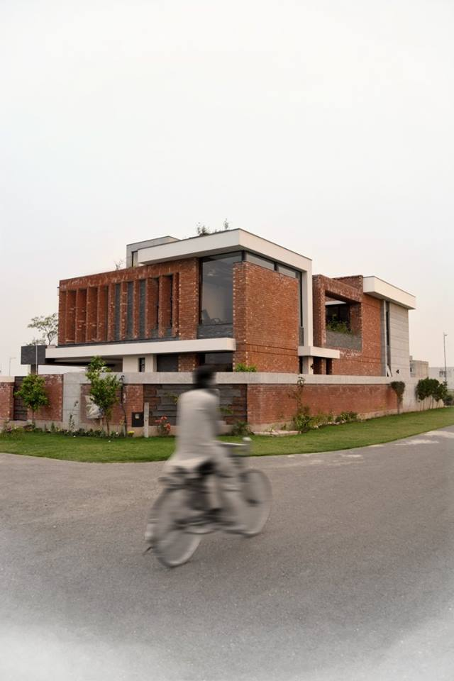 Modern house with red bricks tiles gutka elevation 3d for Modern house design blog