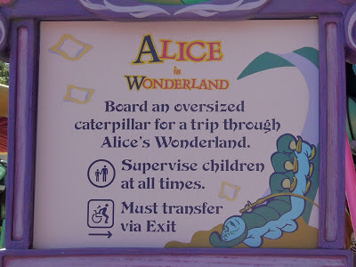 Alice Wonderland Disneyland sign dark ride Fantasyland notice