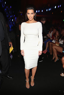 Kim Kardashian posing in the crowd wearing a tigh  white dress at 2012 BET Awards