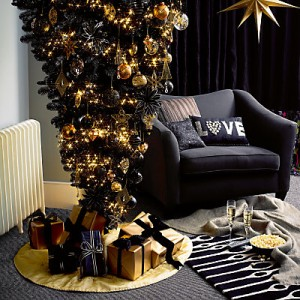upside down tree is my favourite when it comes to fun ideas black christmas tree with gold and black baubles hanging down is so freaking cute