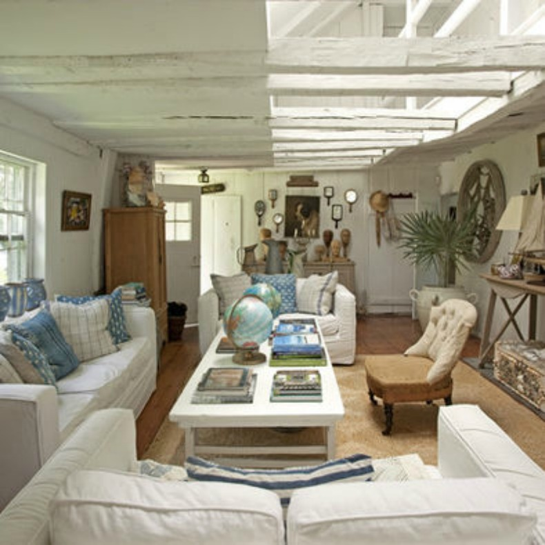 cottage style living room with white slipcover sofas