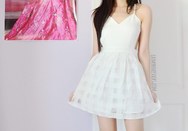 More photos of SheIn's all-white backless gridded-skirt flare dress.