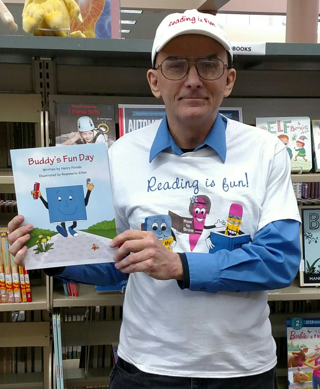 Author holding his second published book