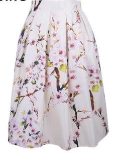 Faldas estampadas plisadas, hasta la rodilla y con cintura elástica