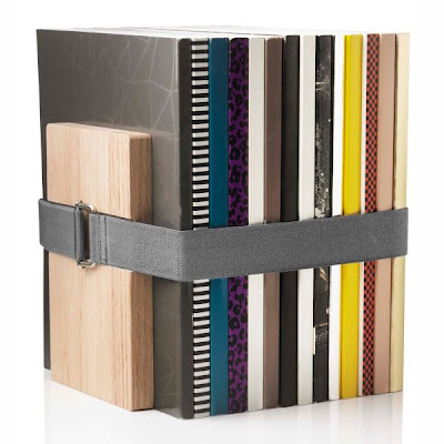 wood blocks and elastic band to keep books upright