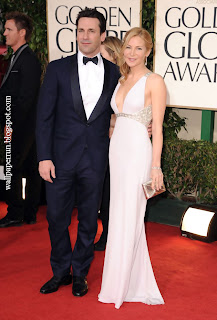 Actor Jon Hamm and actress Jennifer Westfeldt arrive at the 68th Annual Golden Globe Awards