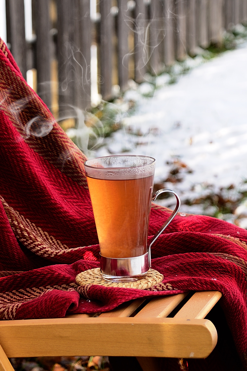 Tea brewed with warm winter spices and a mild fruity flavor of cranberries, especially for the holiday season.