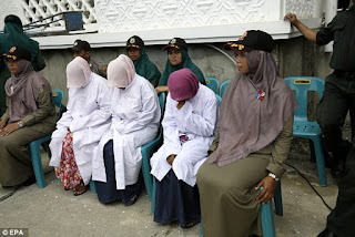 Public caning in Banda Aceh, Indonesia