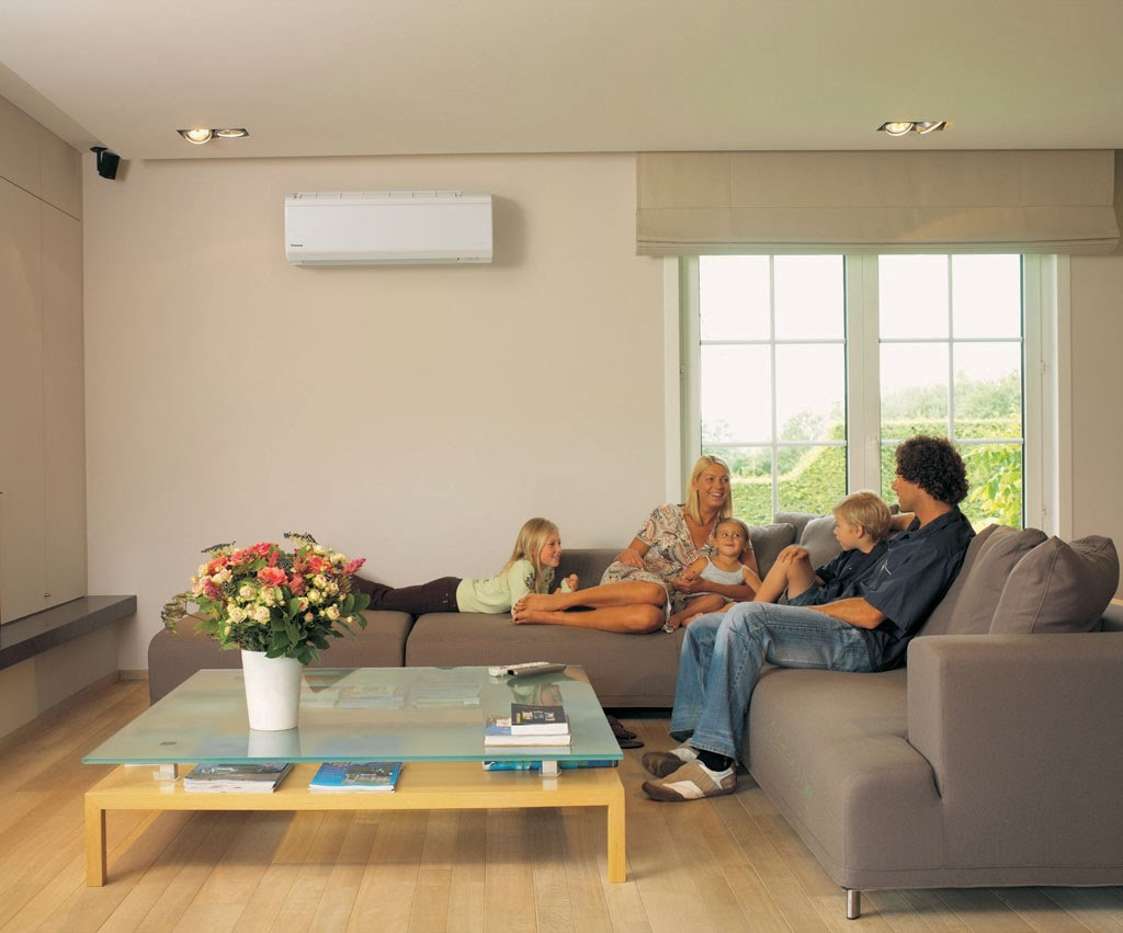 Image of: family in living room fashioned with mini split air conditioner.