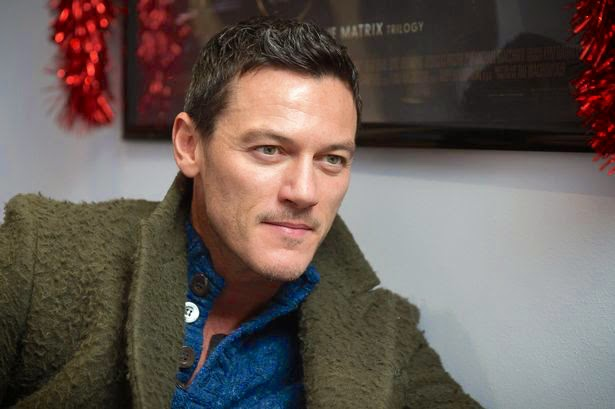 Luke Evans wears green Atelier Scotch coat and blue Peter Scott sweater for The Hobbit The Battle of the Five Armies screening in Blackwood Wales