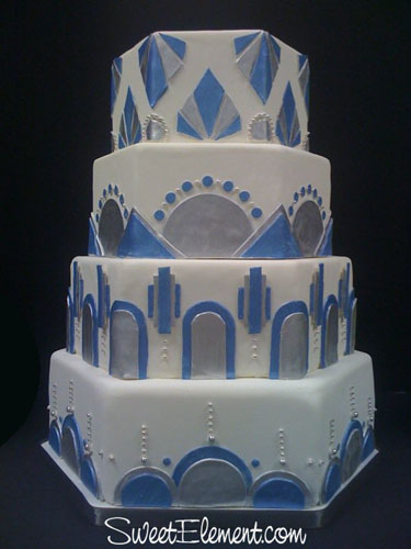 A white blue and silver hexagon shaped Art Deco wedding cake designed by