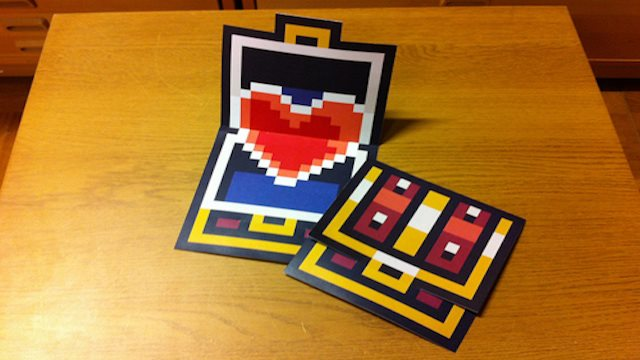 A heart inside a pixelated Zelda Chest
