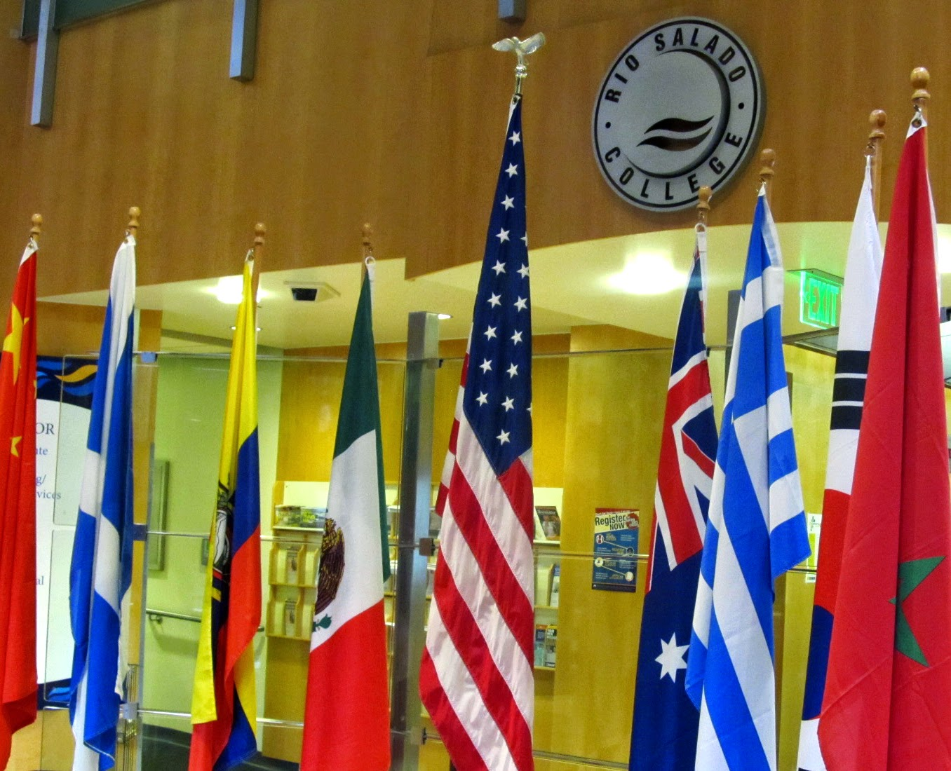 image of flags from different countries displayed in the front reception area of Rio Salado Tempe headquarters
