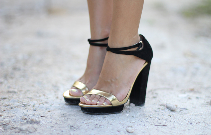 Black and gold heels blogger