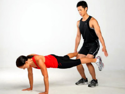 man and woman push ups