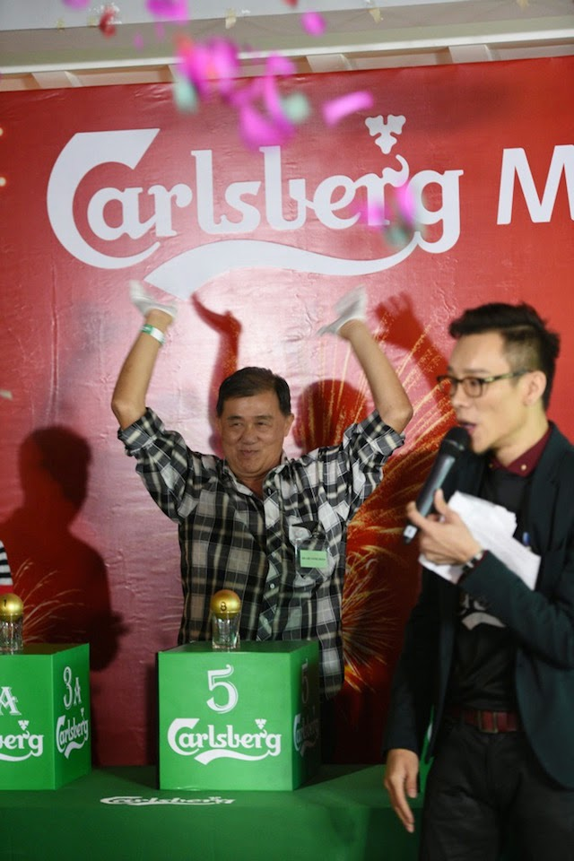 The winning moment: Lim Chong Boon raises his hands in celebration, the moment he is announced as the first ever Carlsberg Millionaire