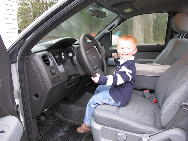 Porter in the Driver Seat of Uncle Len's Truck