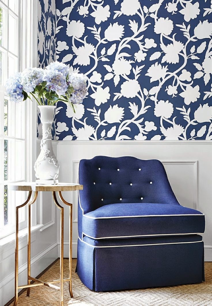navy blue and white living room inspiration with bold wallpaper and gold table
