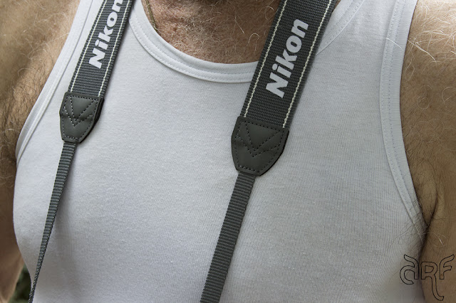man with camera straps
