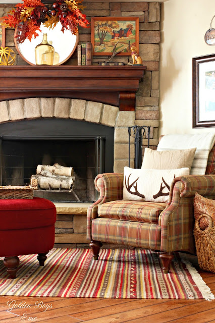 Fall mantel decor on stone fireplace with Birch Lane antler pillow and vintage paint by numbers-www.goldenboysandme.com