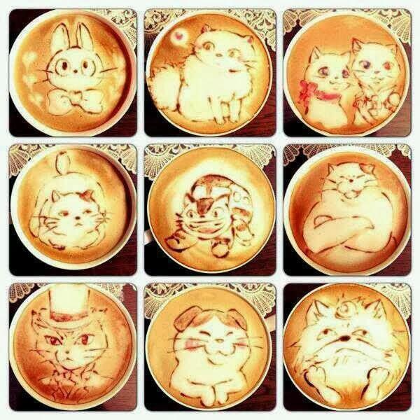 Gatos en el café