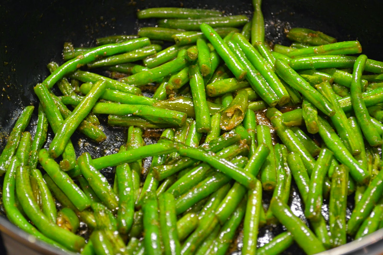 Cook green beans to remove the rawness yet firm to bite